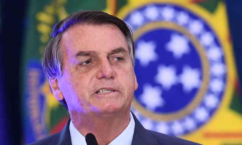 (Oficialmente, o próprio presidente Bolsonaro vetou a tentativa do Congresso de impor o destino de um novo tipo de emenda. Foto: AFP / EVARISTO SA)