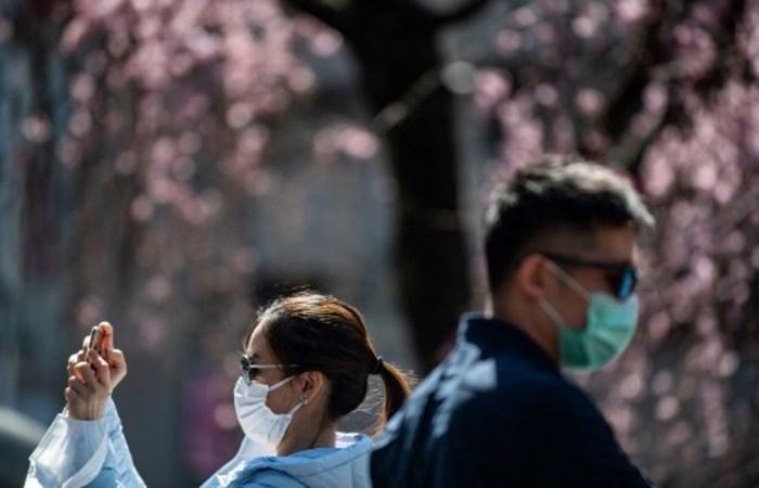 Taxas de infecção não melhoraram no país (Philip FONG / AFP)