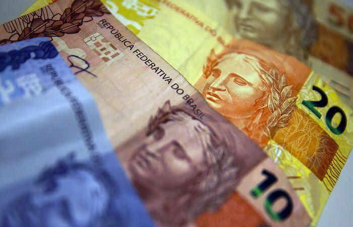 Dinheiro será pago a quem teve contrato suspenso ou jornada reduzida (Marcello Casal Jr/Agência Brasil)