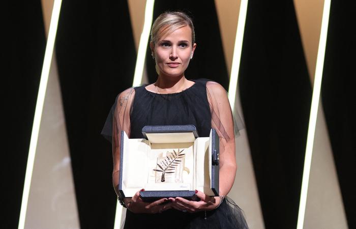 A diretora, mais nova concorrendo, bateu outros grandes nomes com seu filme de terror peculiar (Foto: Valery Hache/AFP)