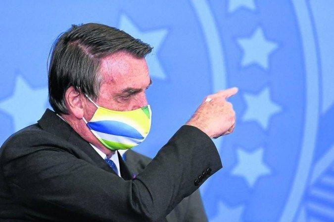 (Presidente da República garante que venceu em primeiro turno na disputa eleitoral contra Fernando Haddad (PT). E atacou o ex-presidente Lula, que está à frente nas pesquisas de intenção de voto. Foto: Evaristo Sa/AFP)