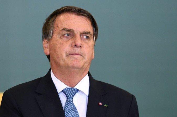 O comprovante de vacinação completo é obrigatório para acessar ao estádio; presidente está passando o final de semana no Guarujá, litoral paulista.  ( Evaristo Sa/AFP)